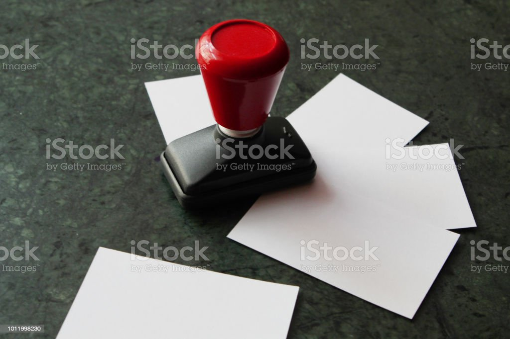 Office paper document stamp with business cards lying around stock office paper document stamp with business cards lying around royalty free stock photo reheart Gallery