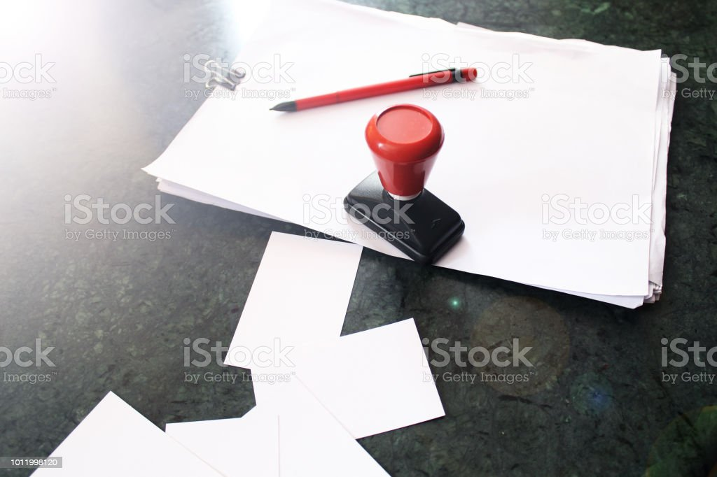 office paper document stamp with business cards papers and red pen