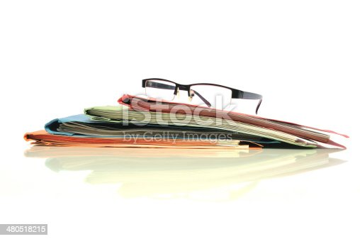 Stack of office folders with glasses