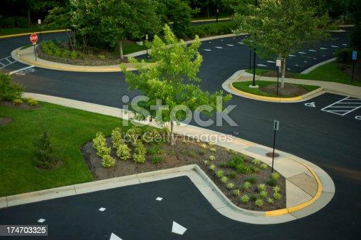Modern landscaped parking lot area in office park.
