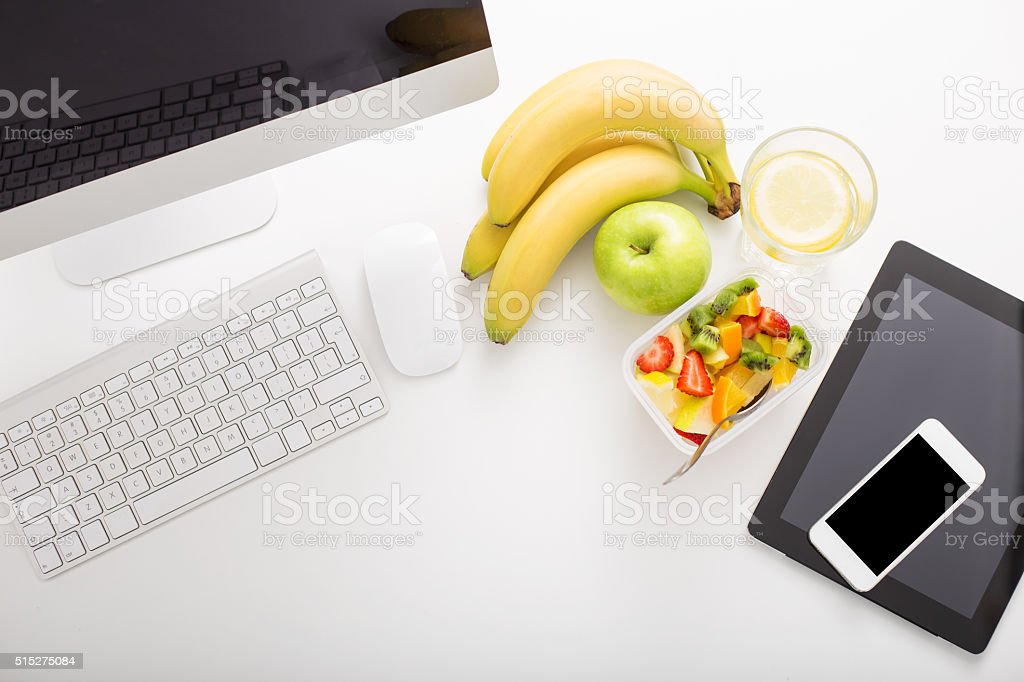 Office set up and fruit stock photo