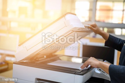 Office staff photocopying at the document maker
