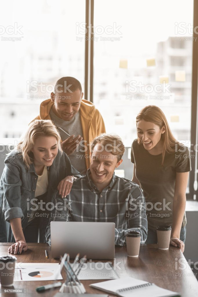 Office staff staring at gadget with interest royalty-free stock photo