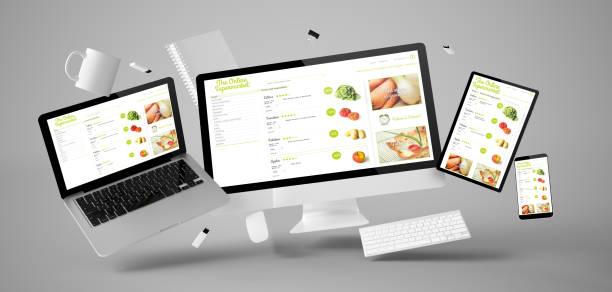 büro-material und geräte schwimmende mit online-supermarkt - webdesigner stock-fotos und bilder