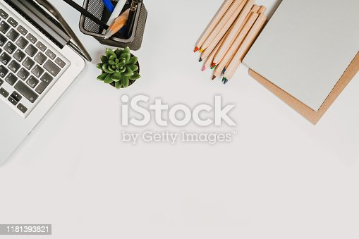 1173922060 istock photo office stuff with with notepad, laptop and coffee, glasses, notepad top view 1181393821