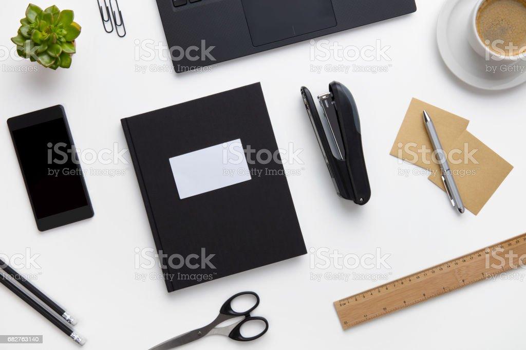Office Supplies And Devices Arranged On White Desk - fotografia de stock