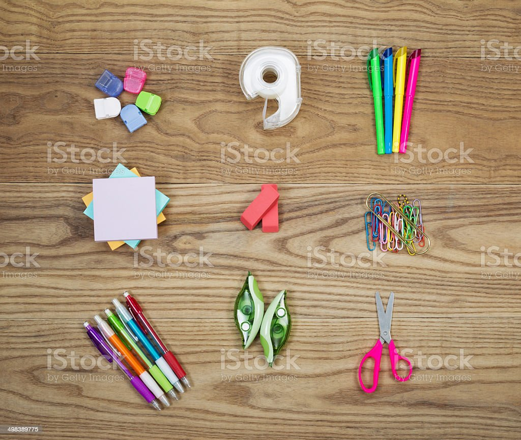 Office Supplies on Aged Wood stock photo