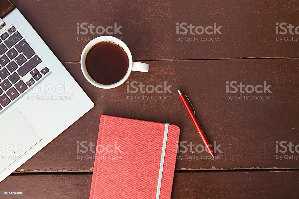 Office supplies on the wooden table