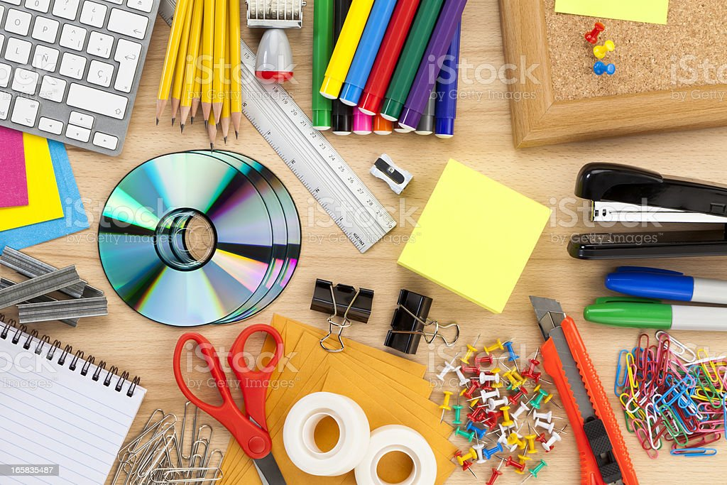 Office supplies on wood desk top shot directly above stock photo