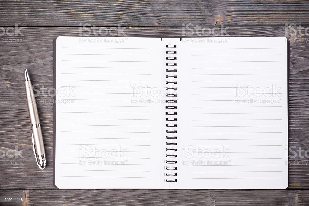 Office supply ballpen with notepad on wooden table stock photo