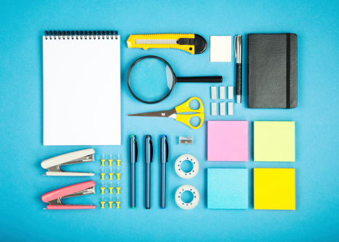 various office supplies in order on the blue background
