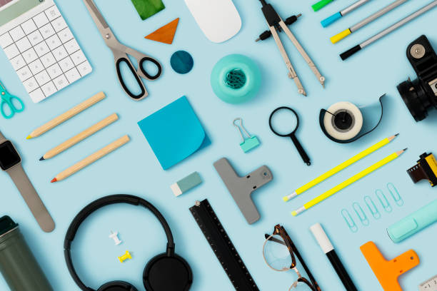 Office supply flat lay on blue background Back to school flat lays on blue background. Office supplies on blue background. knolling concept stock pictures, royalty-free photos & images