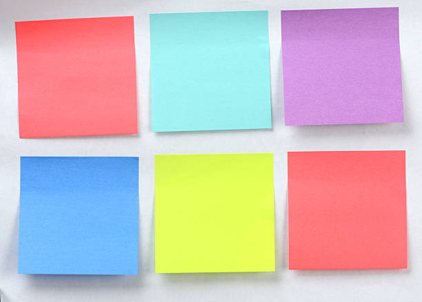 Office Supply Several colorful post it stickers stuck on a wall with copyspace. ASAP stock pictures, royalty-free photos & images