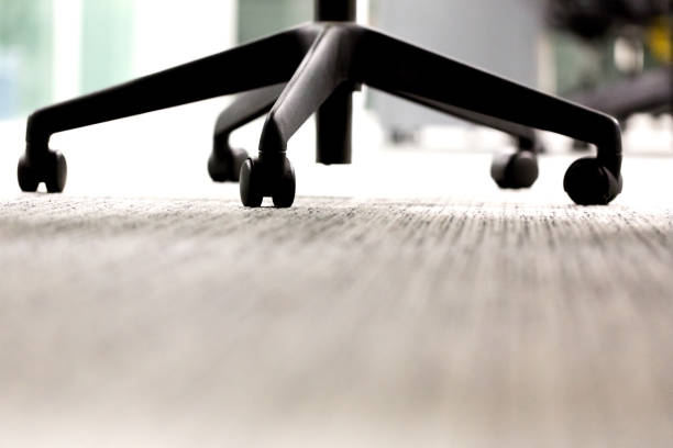 Office swivel chair with wheels very bottom view stock photo