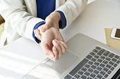 istock Office syndrome hand pain by occupational disease, Closeup business woman with wrist pain, Woman holding her wrist pain from using computer. 680680836