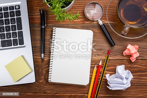 515442844istockphoto Office table desk with set of colorful supplies, white blank 505996262