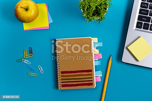 515442844 istock photo Office table desk with set of colorful supplies, white blank 506609250