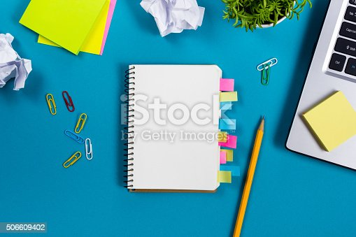 515442844 istock photo Office table desk with set of colorful supplies, white blank 506609402