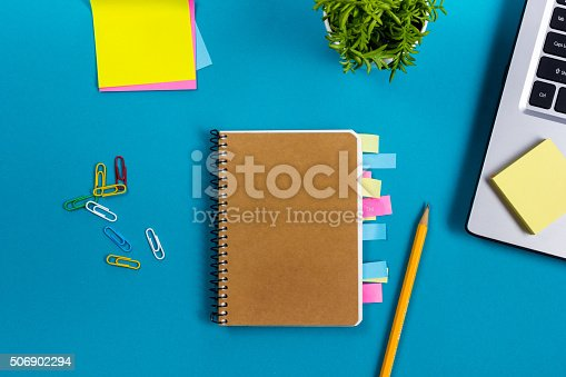 515442844 istock photo Office table desk with set of colorful supplies, white blank 506902294