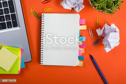 515442844istockphoto Office table desk with set of colorful supplies, white blank 508710476