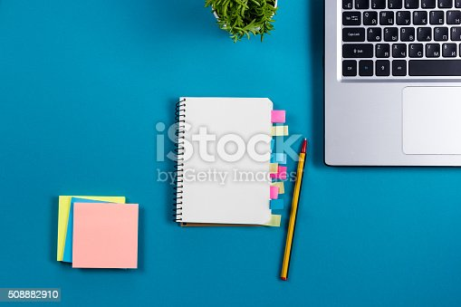515442844 istock photo Office table desk with set of colorful supplies, white blank 508882910