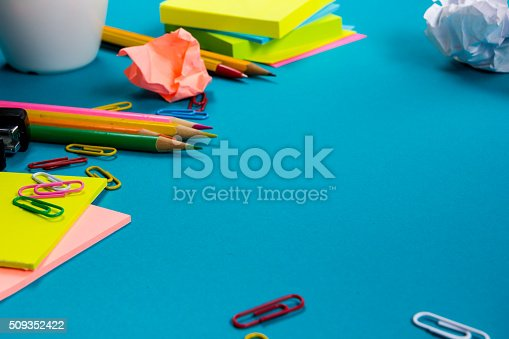 515442844 istock photo Office table desk with set of colorful supplies, white blank 509352422
