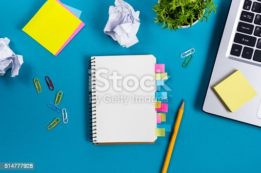515442844 istock photo Office table desk with set of colorful supplies, white blank 514777928