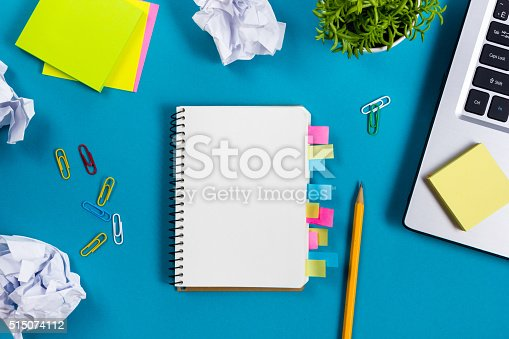 515442844 istock photo Office table desk with set of colorful supplies, white blank 515074112