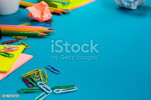 515442844 istock photo Office table desk with set of colorful supplies, white blank 515074212
