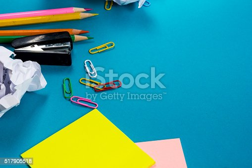 515442844 istock photo Office table desk with set of colorful supplies, white blank 517905518