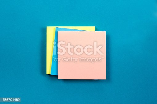 515442844istockphoto Office table desk with set of colorful supplies, white blank 586701482