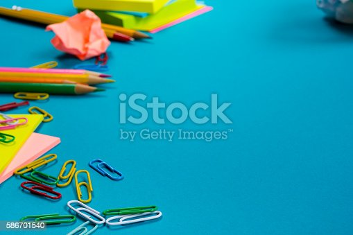 515442844 istock photo Office table desk with set of colorful supplies, white blank 586701540