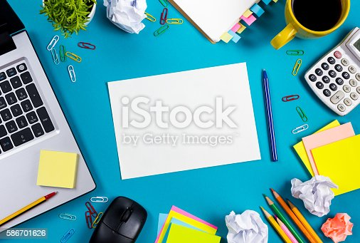515442844 istock photo Office table desk with set of colorful supplies, white blank 586701626