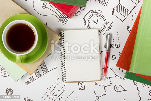 515442844 istock photo Office table desk with supplies, blank note pad, cup, pen 515076568
