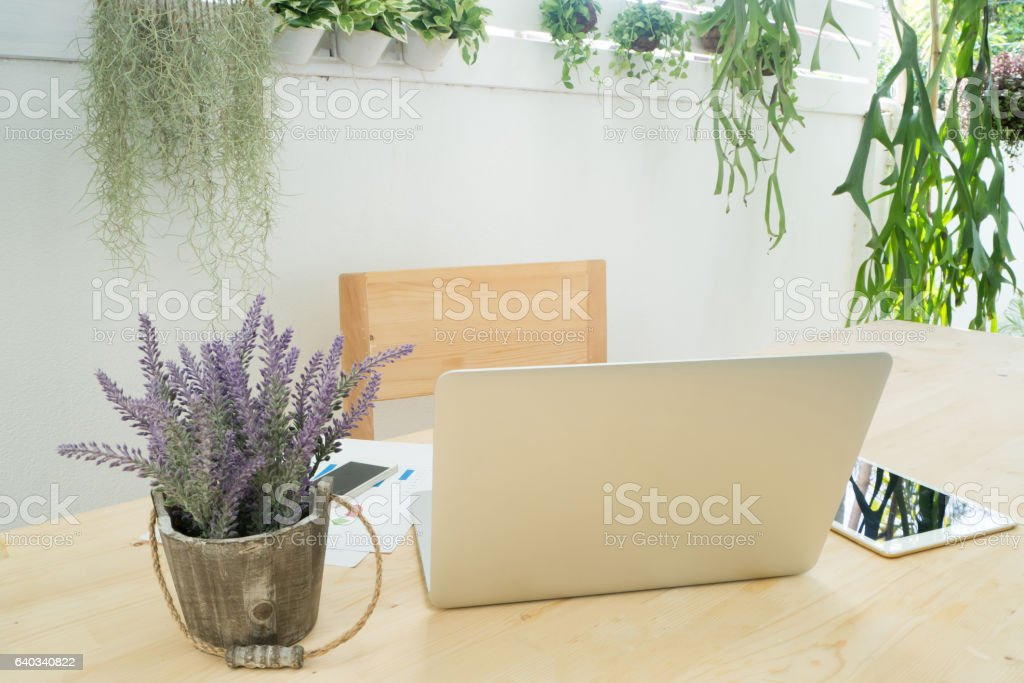 Office table with back of screen laptop, information data, table