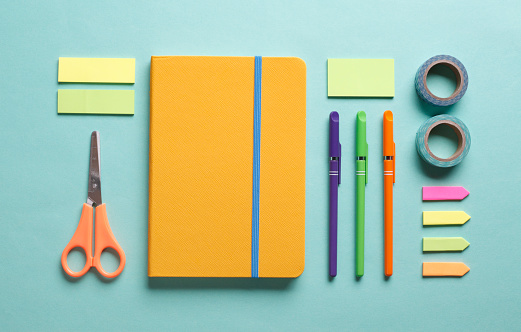 Office desk working space flat lay with colorful supplies