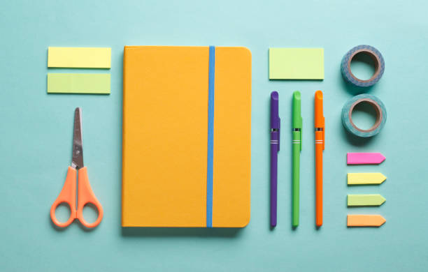 Office Table with Colorful Supplies Office desk working space flat lay with colorful supplies school supplies stock pictures, royalty-free photos & images