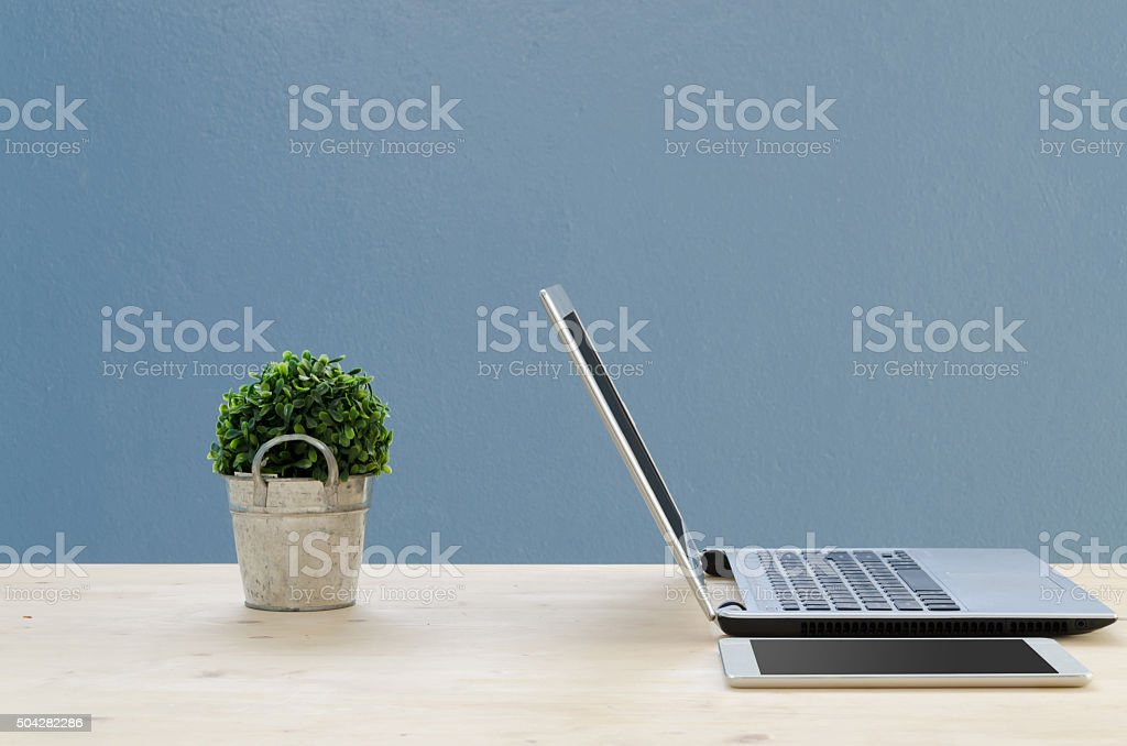 Office table with notepad screen, dried tree and  notebook. stock photo