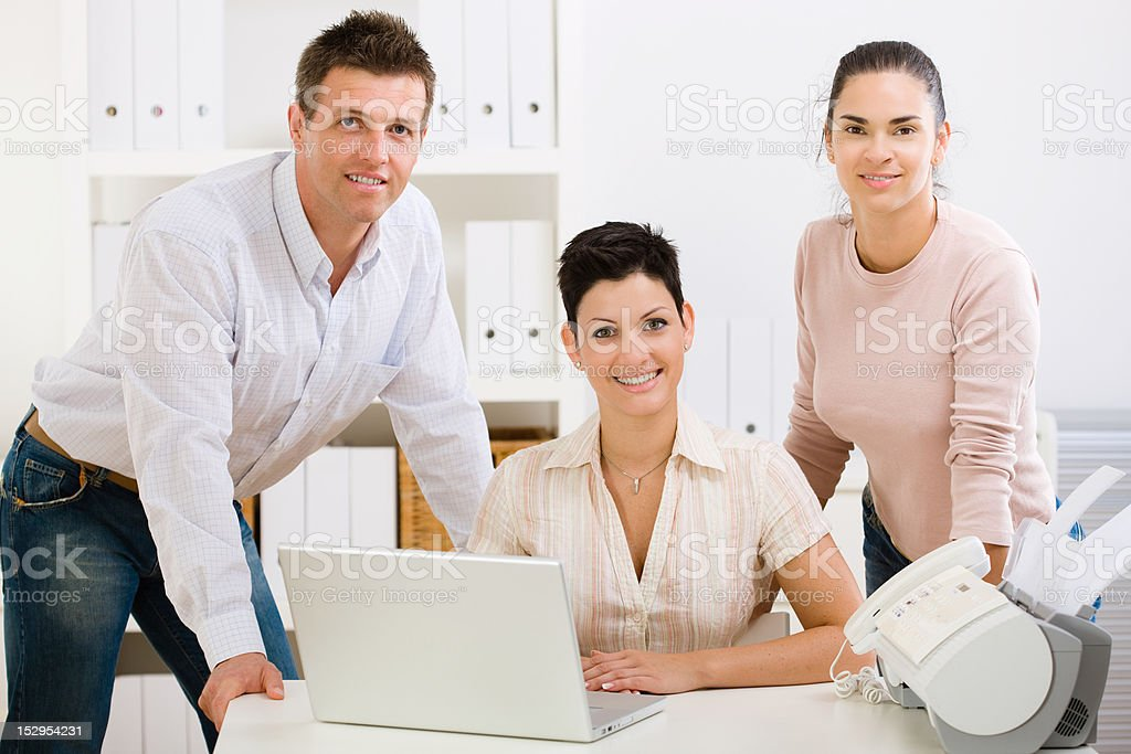 Office team smiling royalty-free stock photo