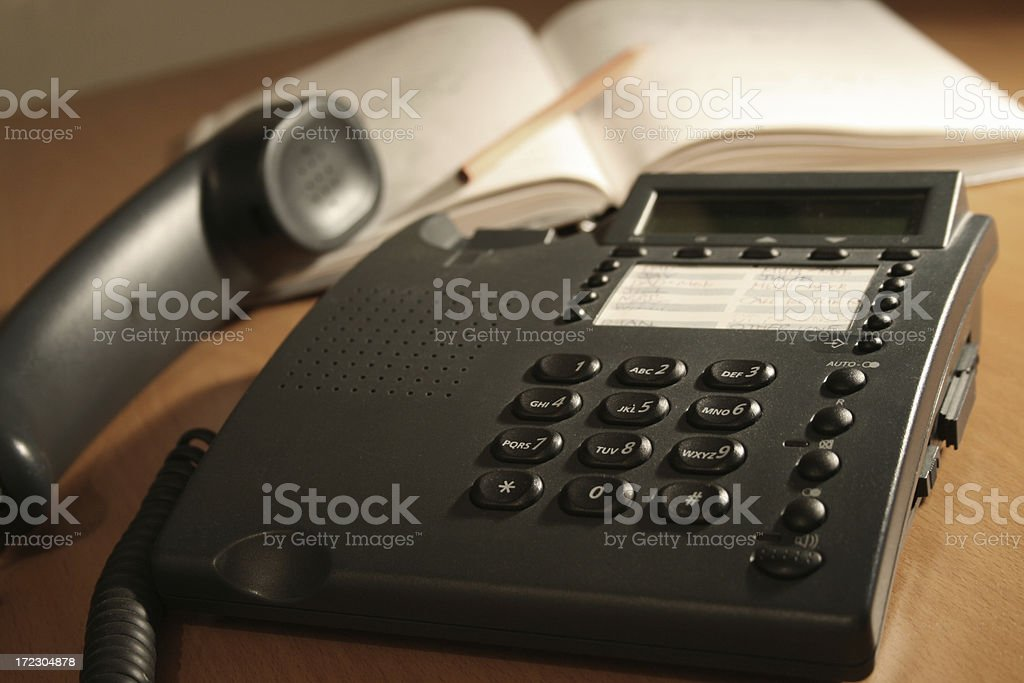 Office Telephone and Open Diary stock photo