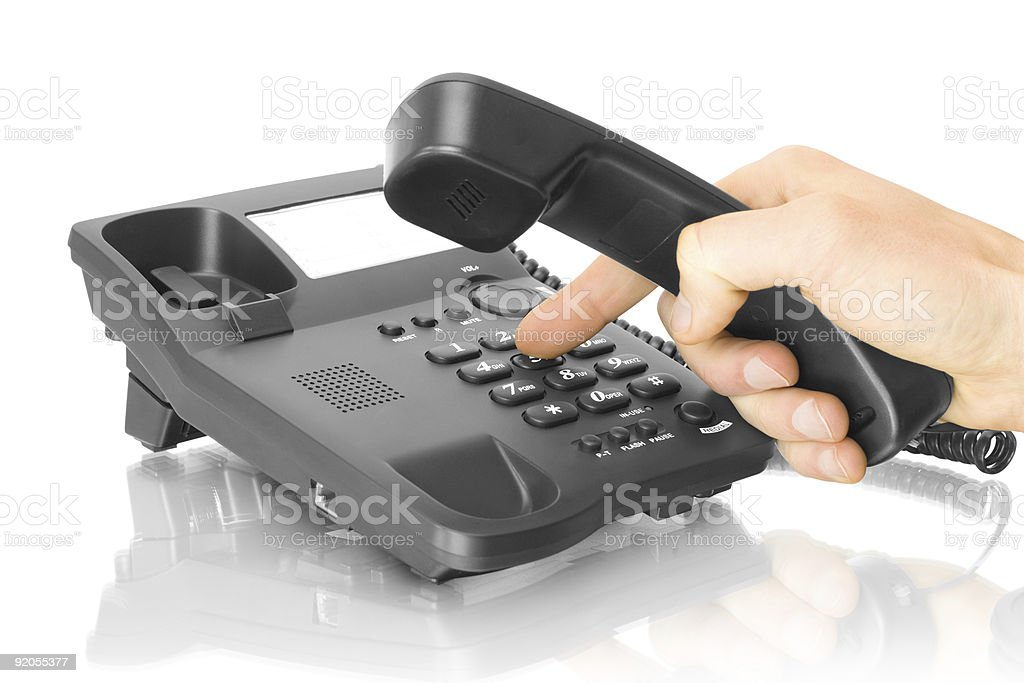 office telephone with hand royalty-free stock photo