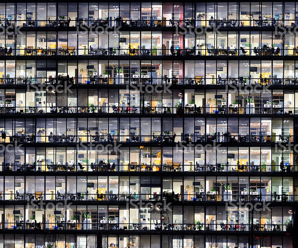 Office windows by night.  Architecture Stock Photo