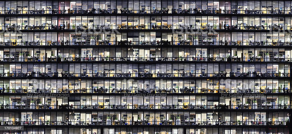 Office windows by night stock photo