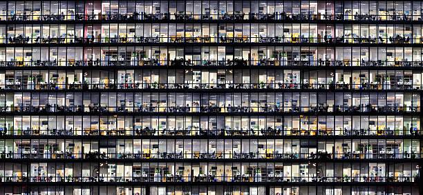 Office windows by night stock photo