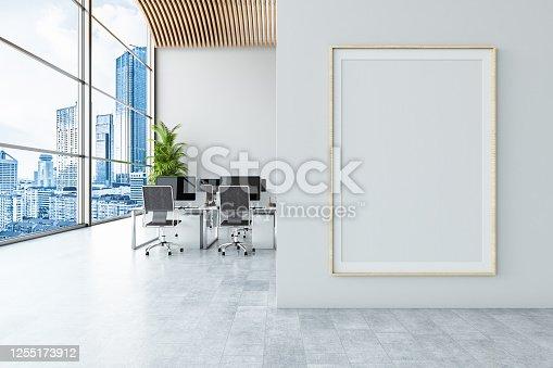 istock Office with Empty Billboard 1255173912
