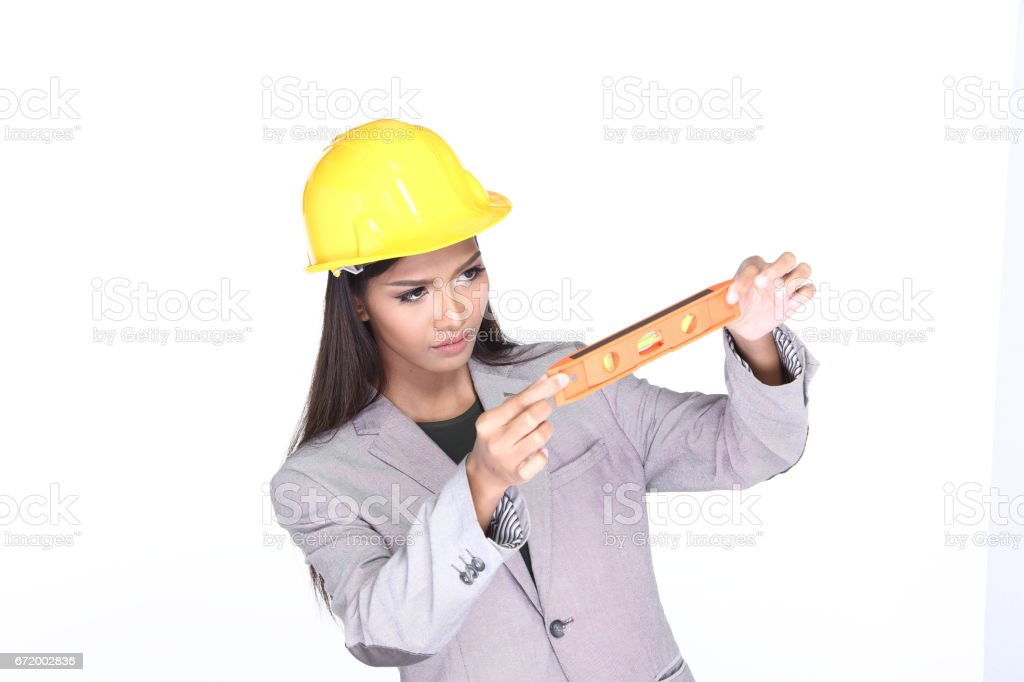 office woman in gray suit wear yellow safety hard hat look at water