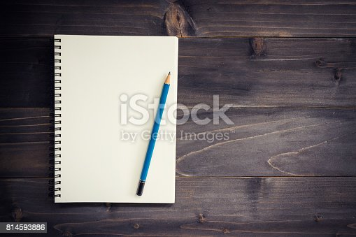 istock Office wood table with blank notepad, pencil. 814593886