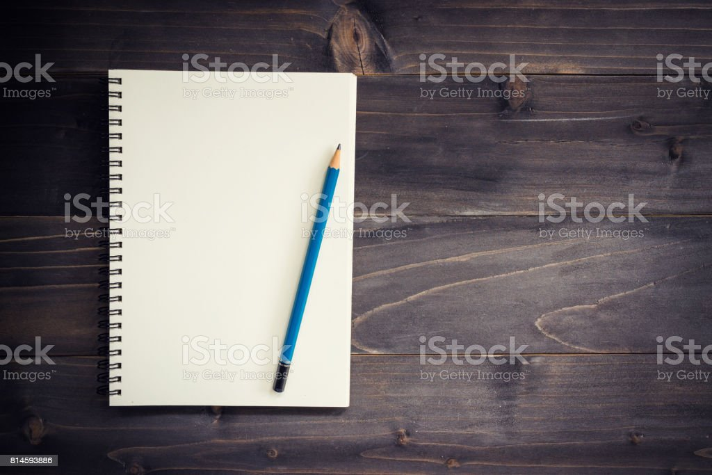 Office wood table with blank notepad, pencil. stock photo