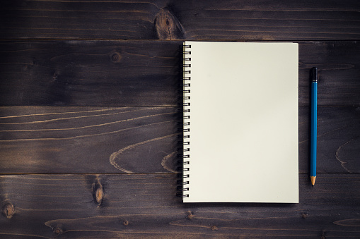istock Office wood table with blank notepad, pencil. 814593928