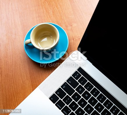 862672018 istock photo Office wood table with  laptop 1128287052